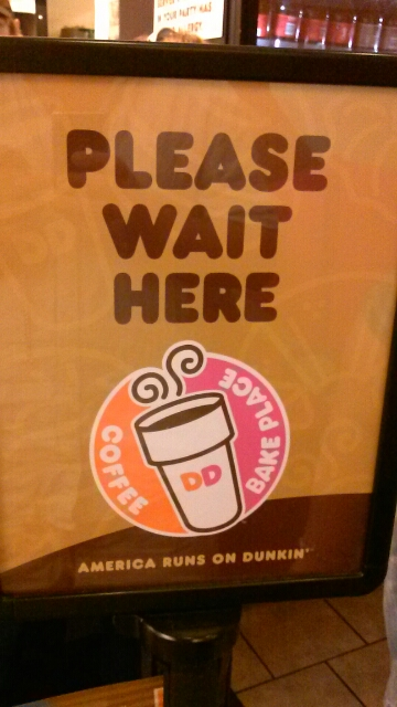 The Waiting Line Sign at Dunkin Donuts